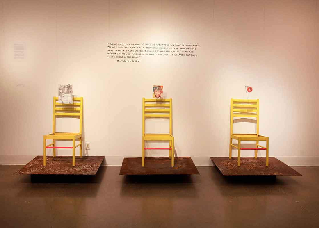 Three Yellow Chairs Against a Wall Art Exhibit